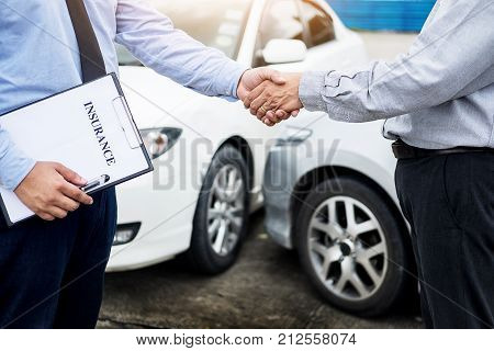 Customer Shake Hand With Auto Insurance Agents After Agreeing To Terms Of Insurance