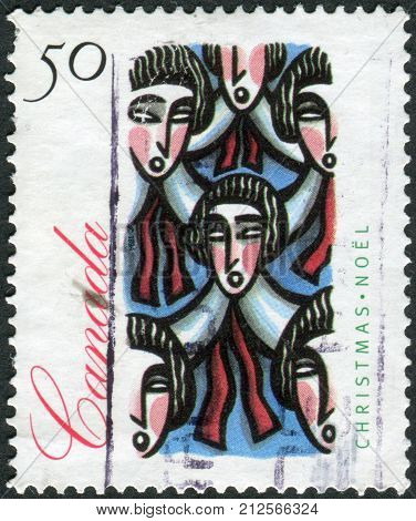 CANADA - CIRCA 1994: Postage stamp printed in Canada Christmas Issue shows Traditional Choir Group circa 1994