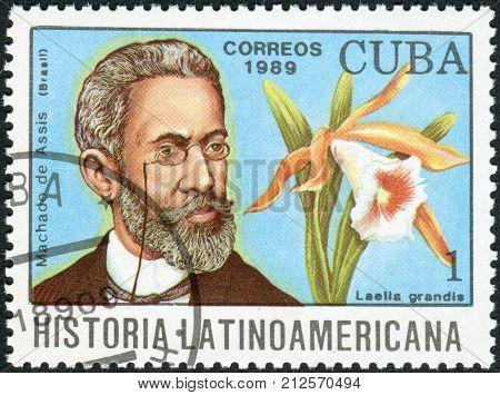 CUBA - CIRCA 1989: Postage stamp printed in Cuba shows the Brazilian writer Joaquim Maria Machado de Assis and orchid Laelia grandis circa 1989