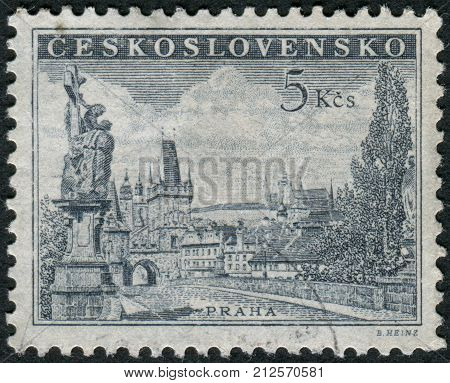 CZECHOSLOVAKIA - CIRCA 1953: Postage stamp printed in Czechoslovakia shows Prague - Charles Bridg statue of St. Luitgard by Matthias Braun and Prague Castle circa 1953