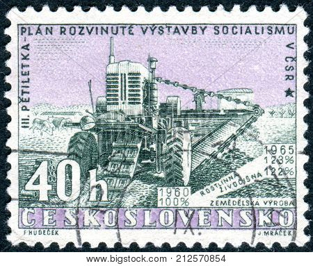 CZECHOSLOVAKIA - CIRCA 1960: Postage stamp printed in Czechoslovakia, Issued to publicize the new five-year plan, shows Harvester