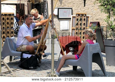 Carcassonne, Languedoc-roussillon, France - August 24 2017: A Street Artist Draws A Young Girl In A