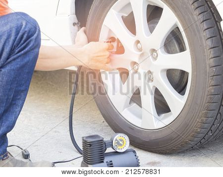 Mechanic checking air pressure with gauge pressure safety concept