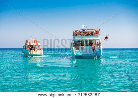 Undefinable People Jumping From A Tourist Cruise Boat Into The Mediterranean Sea. Cyprus.