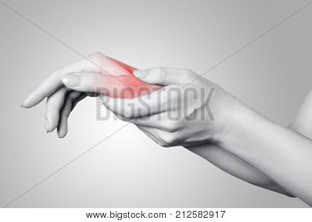 Closeup View Of A Young Woman With Pain On Hand On Gray Background.
