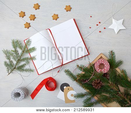 Christmas preparation. Tray with ribbons and Christmas tags, on wooden table