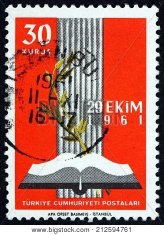 TURKEY - CIRCA 1961: a stamp printed in Turkey shows open book and olive branch inauguration of the new parliament circa 1961