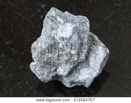 Raw Soapstone Stone ( Talc - Schist ) On Dark
