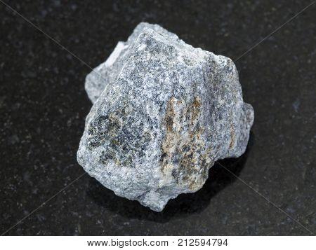 Rough Soapstone Stone ( Talc - Schist ) On Dark