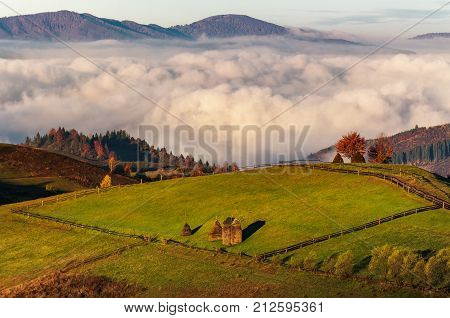 Haystack On Hillside Above The Clouds At Sunrise