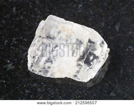 Rough Crystal Of Petalite Gemstone On Dark