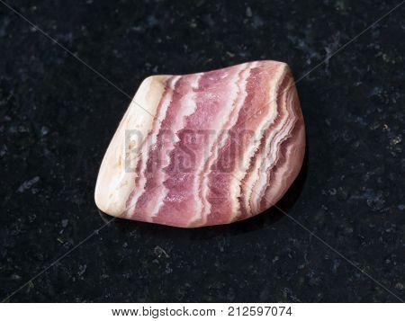Tumbled Rhodochrosite Gem Stone On Dark