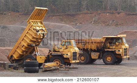 WENTWORTH CANADA - NOVEMBER 03 2017: Caterpillar 769C Off-Highway trucks parked in gravel pit.