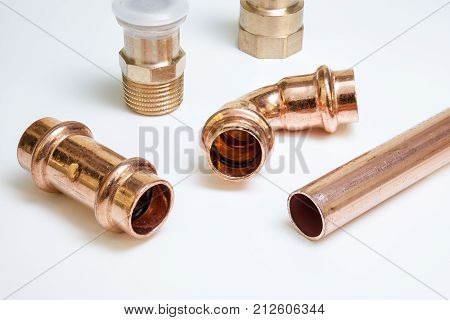 parts of copper with an o-ring seal on white background