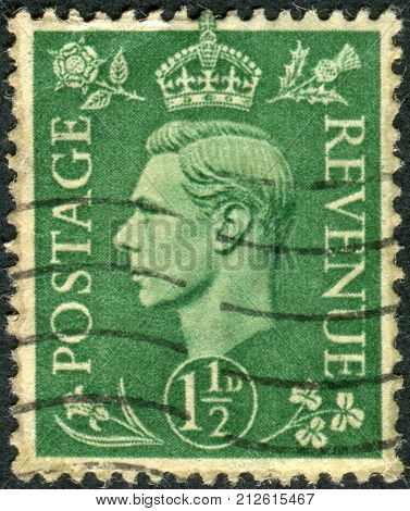 UNITED KINGDOM - CIRCA 1951: Postage stamp printed in England shows King of the United Kingdom and the Dominions of the British Commonwealth George VI circa 1951