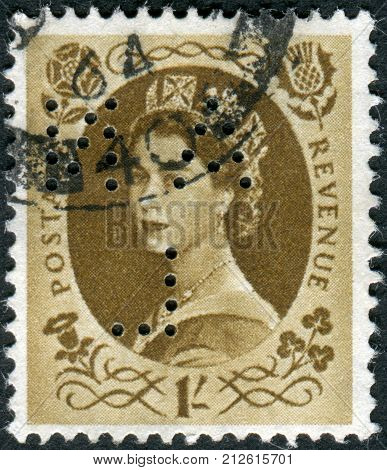 UNITED KINGDOM - CIRCA 1953: Postage stamp printed in England (Perfin) shows a portrait of Queen Elizabeth II circa 1953