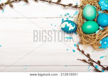 Easter background with eggs nest and catkins copy space