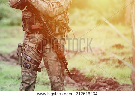 close up on soldier with rifle in hand