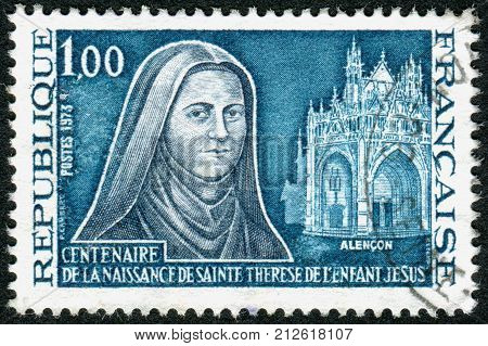FRANCE- CIRCA 1973: Postage stamp printed in France devoted to Centenary of the birth of St. Teresa of Lisieux the Little Flower Carmelite nun circa 1973