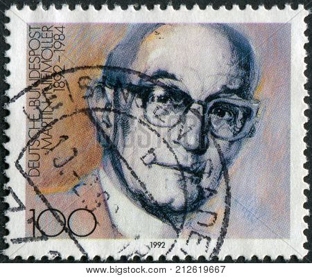 GERMANY - CIRCA 1992: Postage stamp printed in Germany shows a portrait of the German anti-Nazi theologian and Lutheran pastor Friedrich Gustav Emil Martin Niemoeller circa 1992