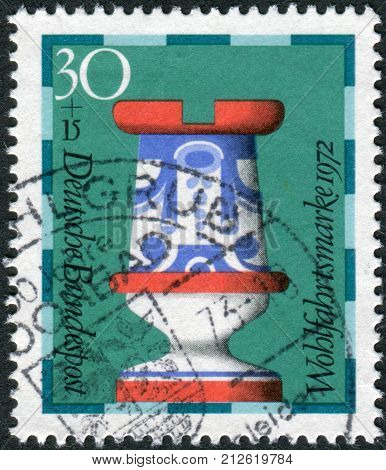 GERMANY - CIRCA 1972: Postage stamp printed in Germany shows a chess piece (rook) of the 19th century made by Faienc Works Gien France; now in Hamburg museum circa 1972
