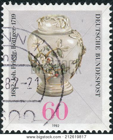 GERMANY - CIRCA 1982: Postage stamp printed in Germany dedicated to the 300th anniversary of Johann Friedrich Bottger originator of Dresden china shown Pear-shaped Pot with Lid circa 1982
