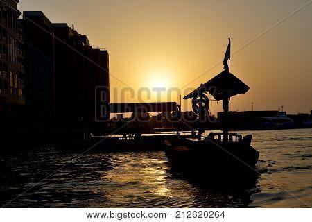 DUBAI UAE - SEPTEMBER 10: The traditional Abra boat in Dubai Creek on September 10 2013 in Dubai United Arab Emirates. The Abra is cheapest transport in Dubai