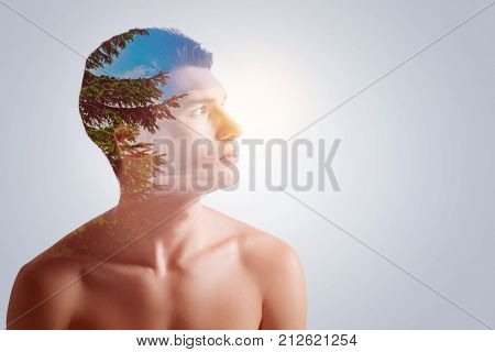 Want to protect. Deep in thought dignified attractive guy concerning about the nature staring into the distance  when his head is in profile