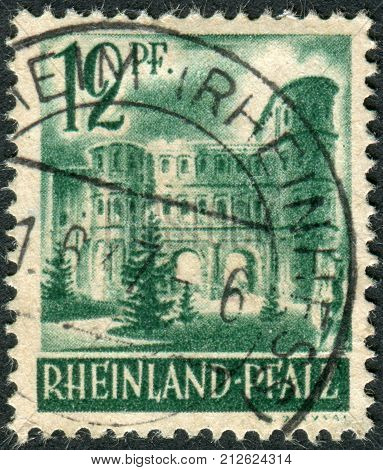 GERMANY - CIRCA 1947: Postage stamp printed in Germany (Rhineland-Palatinate French occupation zone) shows Porta Nigra Trier circa 1947