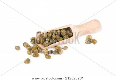 Capers in wooden spoon isolated on white background. Canned capers