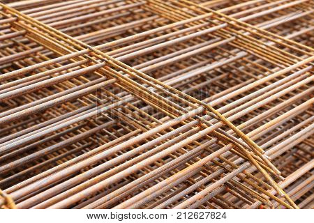 Steel bars for reinforced concrete. Closeup of Steel Bar. Geometric alignment of Re bars on construction site. Rusty is iron rust