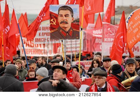 Orel, Russia, November 7, 2017: October Revolution Anniversary Meeting. Stalin Portrait And Many Red