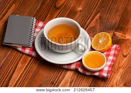 Tea Cup With Honey And Little Notebook Making Cozy Composition