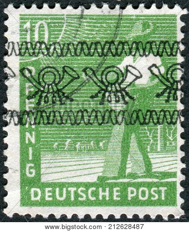GERMANY - CIRCA 1947: Postage stamp printed in Germany (overpint Type A: US and British occupation zone) shows the sower circa 1947