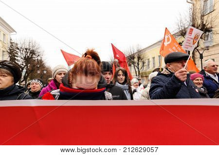 Orel, Russia, November 7, 2017: October Revolution Anniversary Meeting. Girl Hides Her Face From Cam