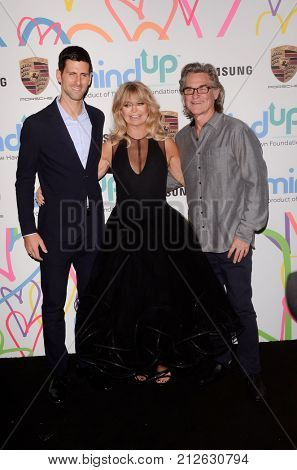 LOS ANGELES - OCT 3:  Novak Djokovic, Goldie Hawn, Kurt Russell at the Goldie's Love In For Kids at the Green Acres Estate on October 3, 2017 in Beverly Hills, CA