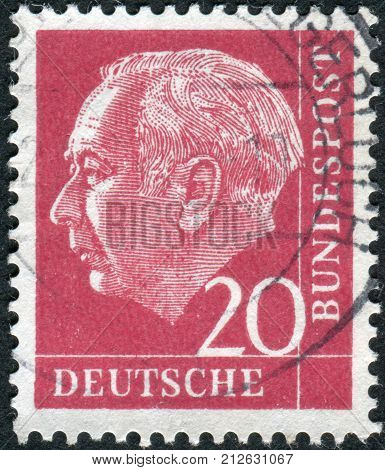 GERMANY - CIRCA 1954: Postage stamp printed in Germany shows the 1st President of the Federal Republic of Germany Theodor Heuss circa 1954