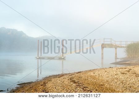 foggy fall morning at a dock and boat ramp on Tennessee River,  Colbert Ferry along Natchez Trace Parkway