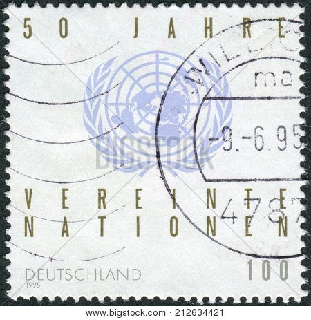 GERMANY - CIRCA 1995: Postage stamp printed in Germany dedicated to the 50th anniversary of the UN shows emblem circa 1995