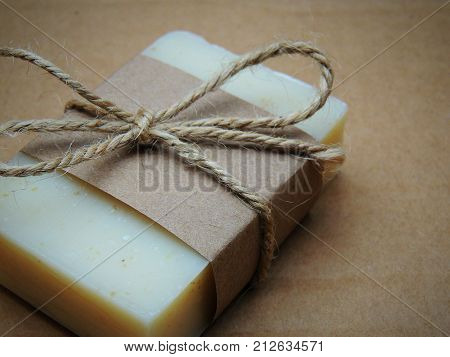 Handmade spa lavender soap on brown background. Soap making. Soap bars. Spa, skin care.