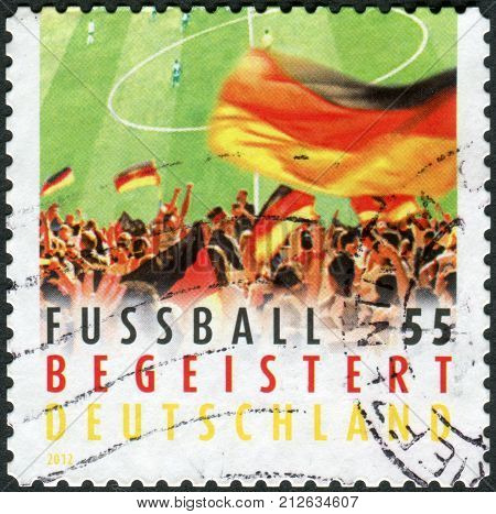 GERMANY - CIRCA 2012: Postage stamp printed by Germany dedicated to the 2012 UEFA European Championship shows German football fans circa 2012