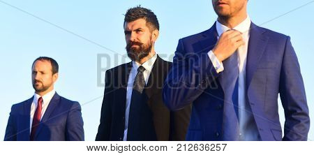 Managers Wear Smart Suits, Ties On Blue Sky Background