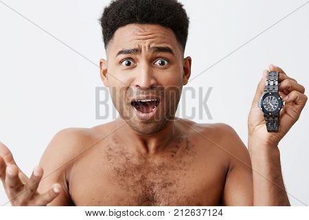 I'm late for meeting. OMG. Bad beginning of day. Attractive beautiful dark-skinned african men with curly hair being frustrating realizing he woke up late and being late for work