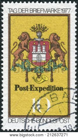 GERMANY - CIRCA 1977: Postage stamp printed in Germany dedicated to stamp day depicted Arms of Hamburg Post Emblem c. 1861 circa 1977