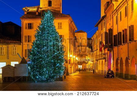 Illuminated Christmas tree in Old City of Alba, Piedmont, Northern Italy.