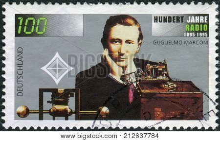 GERMANY - CIRCA 1995: Postage stamp printed in Germany dedicated to the 100th anniversary of the invention of radio shows an engineer physicist and Nobel Prize winner Guglielmo Marconi circa 1995