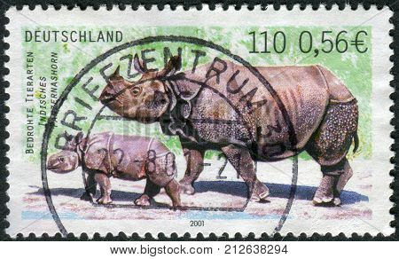 GERMANY - CIRCA 2001: Postage stamp printed in Germany shows the Indian rhinoceros circa 2001