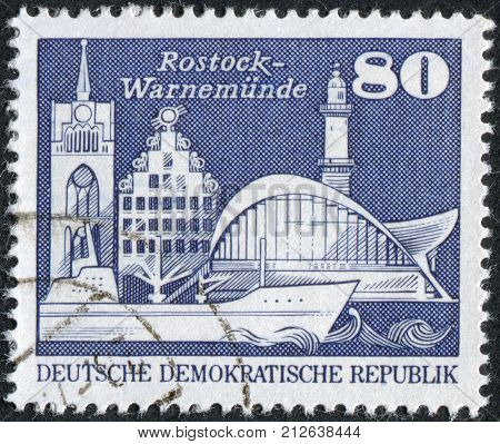 GERMANY (DDR) - CIRCA 1974: Postage stamp printed in Germany shows attractions Kroepeliner Tor Sonne Haus in Rostock and Teepott and lighthouse in Warnemuende circa 1974