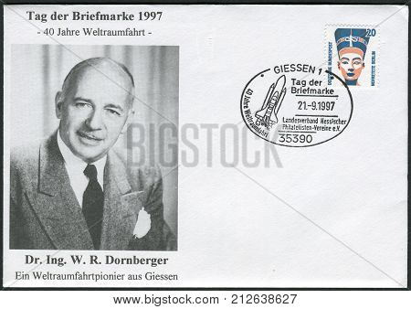 GERMANY - CIRCA 1989: Postage stamp and envelope printed in Germany shows a Queen Nefertiti bust Egyptian Museum Berlin. Dr. Walter Dornberger. Envelope and stamp of 1997 devoted to the 40th anniversary of spaceflight circa 1989