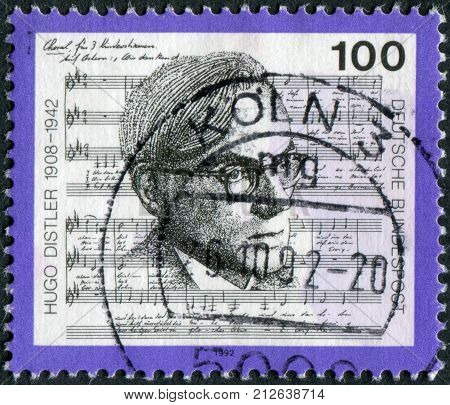 GERMANY - CIRCA 1992: Postage stamp printed in Germany shows a German organist choral conductor teacher and composer Hugo Distler circa 1992